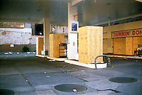 A closed Exxon gas station in the trendy West Chelsea neighborhood of New York in July, 2006. A condominium apartment building is being built in the location. (© Richard B. Levine)