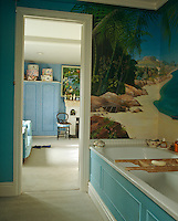 A mural in the bathroom depicting an imaginary beach in paradise was painted by artist Priscilla Kennedy