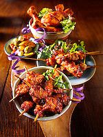 oriental party buffet food with chicken satay