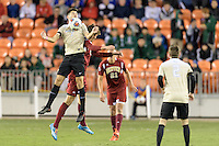 Houston, TX - Friday December 9, 2016: Jon Bakero (7) of the Wake Forest Demon Deacons gains control of a loose ball in the first half against the Denver Pioneers at the  NCAA Men's Soccer Semifinals at BBVA Compass Stadium.