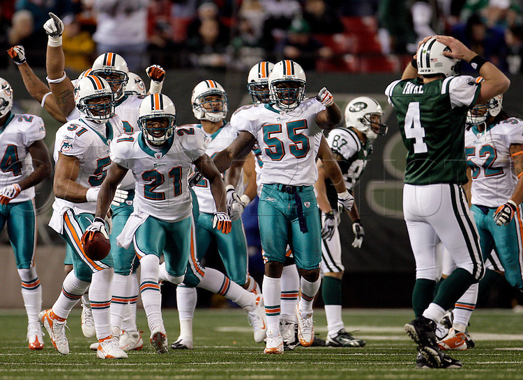 12-28-2008  AL DIAZ / MIAMI HERALD STAFF -- The Miami Dolphins vs New York Jets - Meadowlands - . .Miami's Andre Goodman (21) clebrates after intercepting a Jet's quarterback Brett Favre pass  in the fourth quarter. .AL DIAZ / MIAMI HERALD STAFF