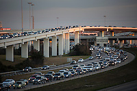 """Late afternoon sun falls on the """"Spaghetti Bowl"""" Mopac exchange in northwest Austin connects Highway 183, Mopac Loop 1 and Loop 360, the Capital of Texas Highway."""