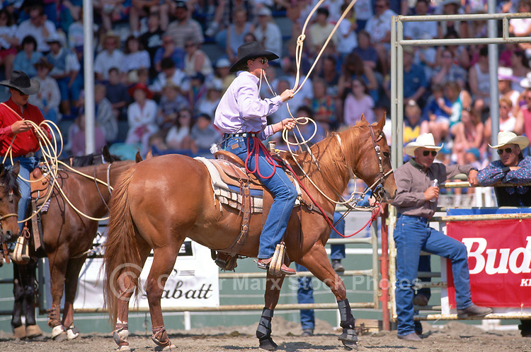 Cowboy with Lasso on Horse ready for Rodeo Calf Roping at the Cloverdale Rodeo, Surrey, British Columbia, Canada