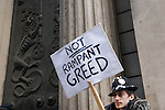 Credit Crunch protest outside Bank of England Threadneedle Street. April 1st 2009. Man holds a sign - Not Rampant Greed outside the Bank of England.