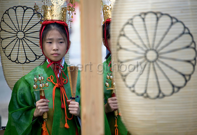 """A young """"yaotome"""" female performer stands with bells and rattles in preparation for the start of the main events of the 3-day Reitaisai festival in Kamakura, Japan on  15 Sept. 2012.  Photographer: Robert Gilhooly"""