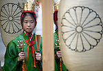 "A young ""yaotome"" female performer stands with bells and rattles in preparation for the start of the main events of the 3-day Reitaisai festival in Kamakura, Japan on  15 Sept. 2012.  Photographer: Robert Gilhooly"
