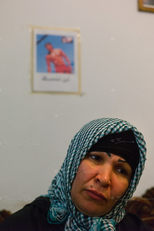 Tunis, January 16, 2011.Zaida Mamnai, (left) under the picture of her dead son, Hilmi Mamnai: he was 23 years old and died from a bullet wound to the chest during a demonstration in central tunis last thursday afternoon..