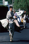 Farmers return from their fields and the dairy cooperative on donkeys in Terceira, Azores. Far out in the Atlantic Ocean, some 850 miles off the western coast of Lisbon, Portugal lies the 425-mile long archipelago of the Azores. (Jim Bryant Photo).....