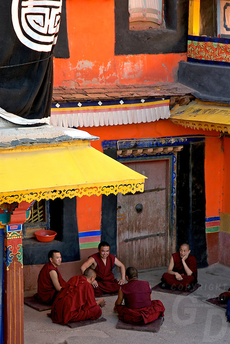 Debating Monks at the Drepung Monastery - Lhasa, Tibet China<br /> Drepung Monastery, located at the foot of Mount Gephel, is one of the &quot;great three&quot; Gelukpa university monasteries of Tibet. The other two are Ganden and Sera<br /> <br /> It was founded in 1416 by Jamyang Choge Tashi Palden (1397&ndash;1449), one of Tsongkhapa's main disciples, and it was named after the sacred abode in South India of Shridhanyakataka.[5] Drepung was the principal seat of the Gelugpa school and it retained the premier place amongst the four great Gelugpa monasteries. The Ganden Podang (dga&acute; ldan pho brang) in Drepung was the residence of the Dalai Lamas until the Great Fifth Dalai Lama constructed the Potala. Drepung was known for the high standards of its academic study, and was called the Nalanda of Tibet, a reference to the great Buddhist monastic university of India.