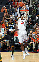 CHARLOTTESVILLE, VA- DECEMBER 6: Akil Mitchell #25 of the Virginia Cavaliers grabs the rebound in front of Bryon Allen #0 of the George Mason Patriots during the game on December 6, 2011 at the John Paul Jones Arena in Charlottesville, Virginia. Virginia defeated George Mason 68-48. (Photo by Andrew Shurtleff/Getty Images) *** Local Caption *** Bryon Allen;Akil Mitchell
