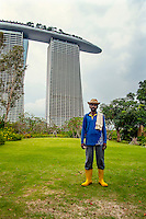 A Bangladeshi gardener stands in the Gardens by the Bay near the Matina Bay Sands resort hotel.