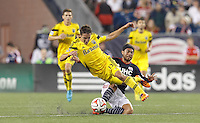 Foxborough, Massachusetts - July 26, 2014:  In a Major League Soccer (MLS) match, Columbus Crew (yellow) defeated the New England Revolution (blue/white), 2-1, at Gillette Stadium.