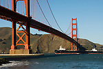 San Francisco, California, Golden Gate Bridge, with ship passing underneath.    Photo copyright Lee Foster. Photo # 1-casanf76399.