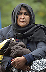 A woman from Afghanistan holds her child in a refugee processing center in the Serbian village of Presevo, not far from the Macedonian border. Hundreds of thousands of refugees and migrants have flowed through Serbia in 2015, on their way from Syria, Iraq and other countries to western Europe.