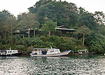 The guest rooms on the hill overlook the Lembeh Resort's dive boat fleet.