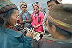 Tamang women discuss a purchase in the market in the village of Gatlang, in the Rasuwa District of Nepal near the country's border with Tibet.