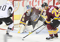 Chicago Wolves goaltender Eddie Lack, center, and Wolves' Steve Reinprecht, right, defend the net against San Antonio Rampage's Jon Matsumoto during the first period of an AHL hockey game, Wednesday, April 4, 2012, in San Antonio. (Darren Abate/pressphotointl.com)
