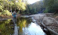 NWA Democrat-Gazette/FLIP PUTTHOFF <br /> Karen Mowry crosses North Sylamore Creek on Oct. 30 2016 during a hike on the North Sylamore Creek Trail.