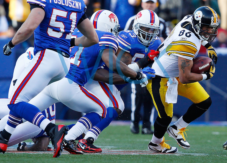 BUFFALO, NY - NOVEMBER 28: Hines Ward #86 of the Pittsburgh Steelers attempts to run through the Buffalo Bills defense during the game on November 28, 2010 at Ralph Wilson Stadium in Orchard Park, New York.  (Photo by Jared Wickerham/Getty Images)