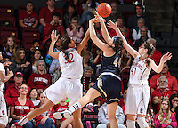 STANFORD, CA - December 22, 2014: Stanford Cardinal vs the UC Davis Aggies at Maples Pavilion.  Stanford defeated the Aggies 71-59. Kailee Johnson (32) blocks Aggies' Alyson Doherty's (44) shot.