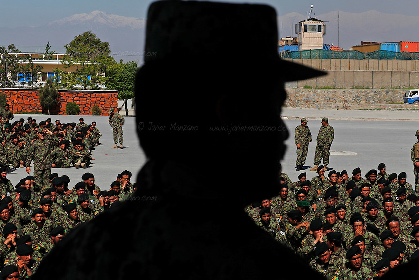 Hundreds of newly graduated Afghan National Army soldiers wait for their deployment orders at a training facility in the outskirts of Kabul, Afghanistan. NATO's initial goal of reaching 320,000 Afghan National Security Forces will be slashed to a mere 220,000 ANSF - many analysts sustain that this is not an adequate number to achieve the security goals of post 2014 Afghanistan (and the year when most NATO troops are scheduled to leave). ©Javier Manzano