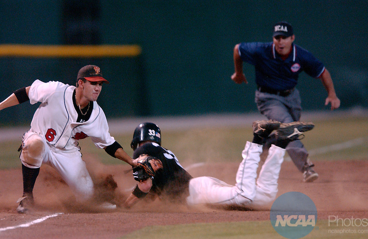 31 MAY 2003: Central Missouri State, right fielder, (33) Stephen Downey slides safely into third as Tampa third baseman Billy Wimberly (6) applies the tag during the NCAA Division 2 Men's Baseball Championship at Paterson Field in Montogmery, Ala. Central Missouri State defeated Tampa 11-4. Cliff Williams/NCAA Photos