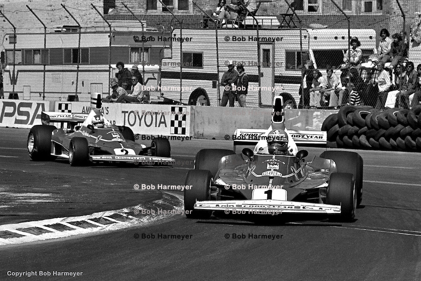 LONG BEACH, CA: Niki Lauda, #1 Ferrari 312T 023/Ferrari 015, and Clay Regazzoni, #2 Ferrari 312T 024/Ferrari 015, drive during the morning warmup session for the inaugural United States Grand Prix West on March 28, 1976, on the temporary street circuit in Long Beach, California.