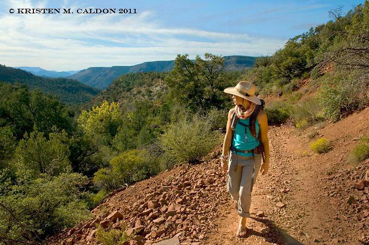 A hiker enjoys the Fossil Springs Trail, which starts near Strawberry, AZ. This is a relatively easy trail which can be very busy with families during warm weather.