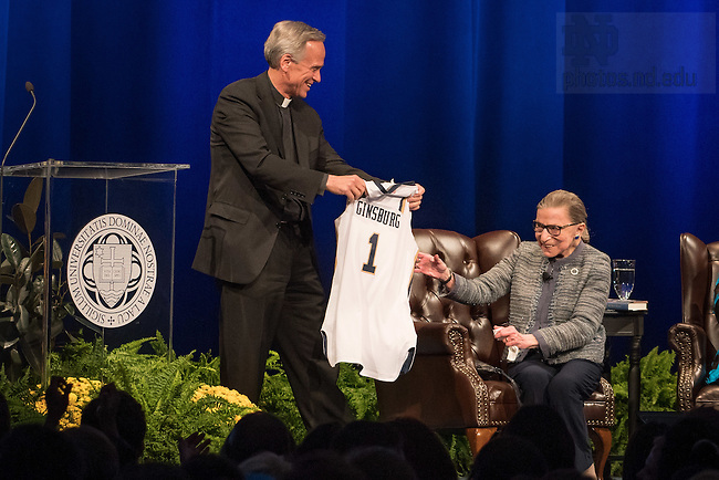 September 12, 2016; Notre Dame President Rev. John I. Jenkins, C.S.C. presents a Notre Dame Women's Basketball jersey to U.S. Supreme court Justice Ruth Bader Ginsburg following a conversation with Justice Ginsburg at the Purcell Pavilion. (Photo by Matt Cashore/University of Notre Dame)