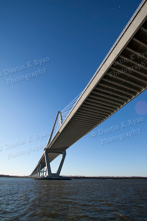 Arthur Ravenel Jr Bridge Charleston South Carolina also known as the Cooper River Bridge.  Blue skies and container ships