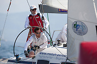 Peter Gilmour of Australia helms as Cristian Ponthiue trims the headsail during a quarter final match against Torvar Mirsky of Australia. Match Race Germany 2010. World Match Racing Tour. Langenargen, Germany. 23 May 2010. Photo: Gareth Cooke/Subzero Images/WMRT