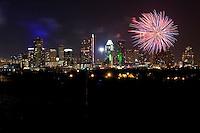 Bright Fireworks paint the downtown Austin, Texas Skyline.