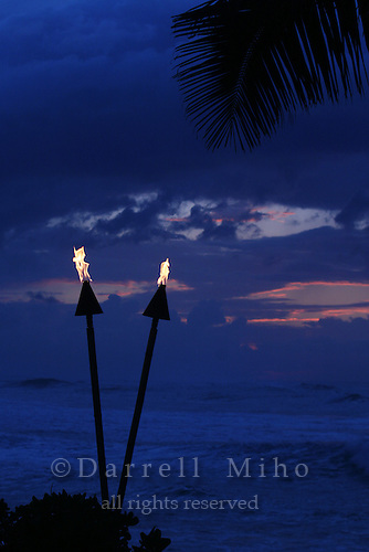 Feb. 17, 2006; Kahuku, Oahu, HI - Tiki torches burn at the Turtle Bay Resort on the north shore of Oahu...Photo Credit: Darrell Miho.© Darrell Miho