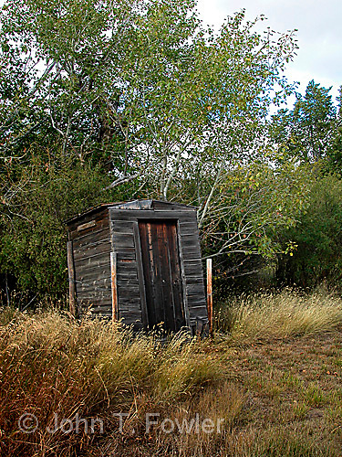 Privy outhouse on abandoned farmstead in southern Saskatchewan, Canada