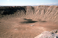 METEOR CRATER<br /> Barringer Meteorite Crater, Arizona<br /> 50,000 years ago an iron-nickel meteorite, approx.150 feet across and weighing several hundred thousand tons, struck the Earth at roughly 30,000 mph with the force of 20mil tons of TNT. In a few seconds the 700 ft deep, 4,000 ft across crater was formed.
