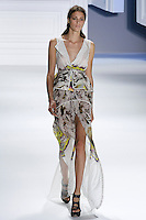 Claire de Regge walks runway in a White psychedelic printed silk chiffon tiered high-low gown with psychedelic printed peplum drawstring belt, by Vera Wang, for the Vera Wang Spring 2012 collection, during Mercedes-Benz Fashion Week Spring 2012.
