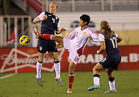 BOCA RATON, FL - DECEMBER 15, 2012: Becky Sauerbrunn (4) of the USA WNT loses the ball to Han Peng (18) of China WNT during an international friendly match at FAU Stadium, in Boca Raton, Florida, on Saturday, December 15, 2012. USA won 4-1.