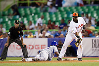 10 March 2009: #7 Jose Reyes of the Dominican Republic makes it back to first base safely to avoid a pick off play by #35 Randall Simon of the Netherlands during the 2009 World Baseball Classic Pool D game 5 at Hiram Bithorn Stadium in San Juan, Puerto Rico. The Netherlands pulled off second upset to advance to the secound round. The Netherlands come from behind in the bottom of the 11th inning and beat the Dominican Republic, 2-1.