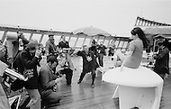 07 May 1969 --- Photographers photograph a young woman passenger aboard the Queen Elizabeth II cruise liner at the west pier in New York Harbor during the liner's maiden voyage from Southampton, England to New York City. --- Image by © JP Laffont/Sygma/Corbis