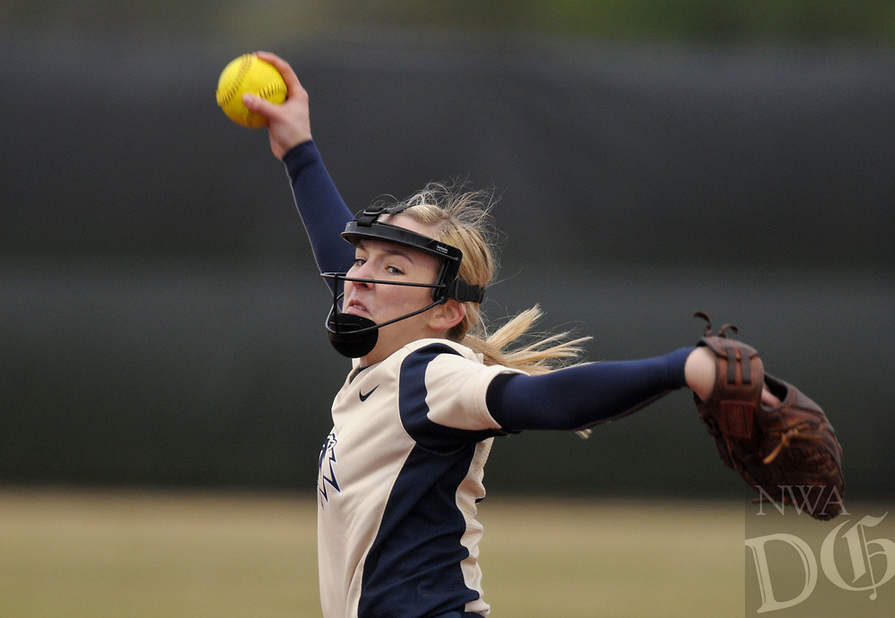 NWA Democrat-Gazette/BEN GOFF @NWABENGOFF<br /> Emma Wood of Bentonville West pitches to a Springale Har-Ber batter Thursday, March 30, 2017, during the game at Bentonville West in Centerton.