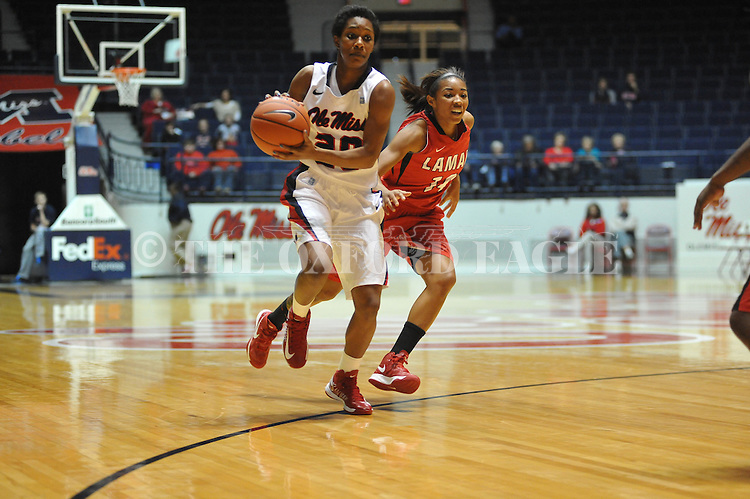 Ole Miss' Amber Singletary (20) vs. Lamar's Carenn Baylor (14) in women's college basketball at the C.M. &quot;Tad&quot; Smith Coliseum in Oxford, Miss. on Monday, November 19, 2012.  Lamar won 85-71.