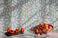 Castilla, a jewel glass water jet and hand cut mosaic shown in Quartz and Aquamarinel, is part of the Miraflores Collection by Paul Schatz for New Ravenna Mosaics.