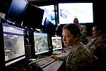 Intelligence analyst Senior Airman Sara Kennely, right, works on the operations floor at Beale Air Force Base in Linda, Calif., April 7, 2010.
