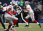 New York Giants quarterback Eli Manning (10) rolls out to pass against the Seattle Seahawks  at CenturyLink Field in Seattle, Washington on November 9, 2014. The Seahawks  beat the Giants 38-17. ©2014. Jim Bryant Photo. All rights Reserved.