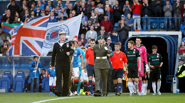 Members of the Armed Forces leading out the teams at Ibrox
