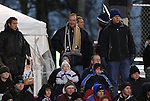 11 December 2009: Former Indiana coach Jerry Yeagley (center, with Akron scarf) watches the game. The University of Virginia Cavaliers defeated the Wake Forest University Demon Deacons 2-1 after overtime at WakeMed Soccer Stadium in Cary, North Carolina in an NCAA Division I Men's College Cup Semifinal game.