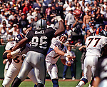 Oakland Raiders vs. Denver Broncos at Oakland Alameda County Coliseum Sunday, September 20, 1998.  Broncos beat Raiders  34-17.  Denver Broncos quarterback John Elway (7) passe over Oakland Raiders defensive end Darrell Russell (96).