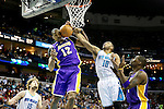 Mar 6, 2013; New Orleans, LA, USA; New Orleans Hornets guard Eric Gordon (10) and Los Angeles Lakers center Dwight Howard (12) reach for the ball during the third quarter at the New Orleans Arena. Los Angeles defeated New Orleans 108-102. Mandatory Credit: Crystal LoGiudice-USA TODAY Sports