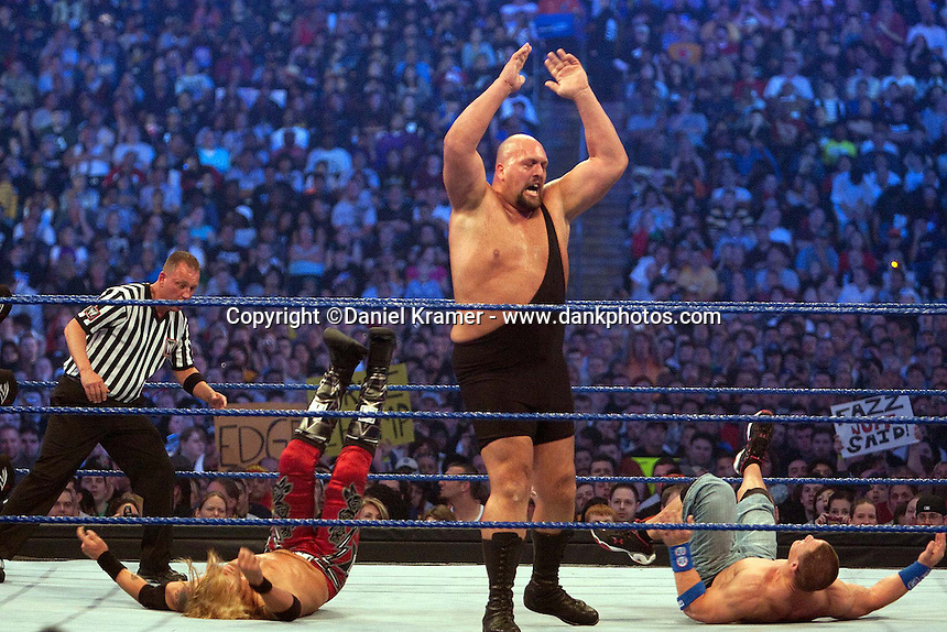 Big Show knocks over both John Cena and Edge in a Triple Threat match at WrestleMania 25 at Reliant Stadium on April 5, 2009 in Houston, Texas.