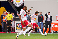 Thierry Henry (14) of the New York Red Bulls grabs his hamstring as Mehdi Ballouchy (10) passes the ball during the first half against the New England Revolution during a Major League Soccer (MLS) match at Red Bull Arena in Harrison, NJ, on April 28, 2012.